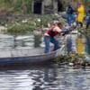 Emlur implanta 'ecobarreira' no rio Jaguaribe para conter lixo