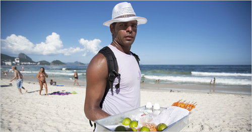 The mayor's ban on sales of freshly cooked foods like steak and shrimp on the sand will hit Copacabana beach later this month. André Vieira for The New York Times