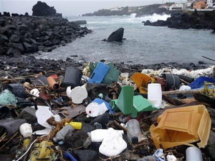 In this Feb. 15, 2010 photo released by 5 Gyres, a coastal area of the Azores Islands in Portugal, is shown littered with plastic garbage. Researchers are warning of a new blight on the North Atlantic ocean: a swirl of confetti-like plastic bits, bottle caps and other refuse stretching for thousands of square miles. (AP Photo/5 Gyres)