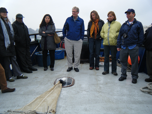 Workshop attendees getting briefed on the manta-net during a quick trip on the water to sample for microplastics in Commencement Bay Photo Credit: Sherry Lippiatt